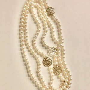 Long strand faux pearl necklace